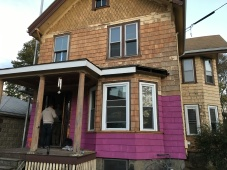 The paint supplier tinted our primer for us, since the color of the house will be dark... so we temporarily have a hot pink house!